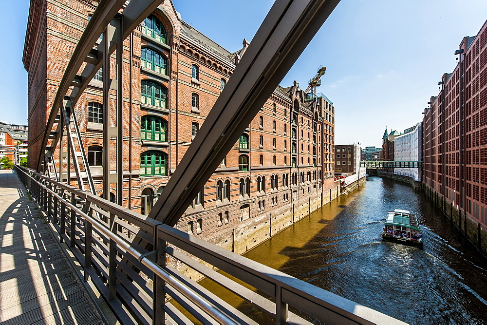 Excursion boat passing Speicherstadt, Hamburg, Germany