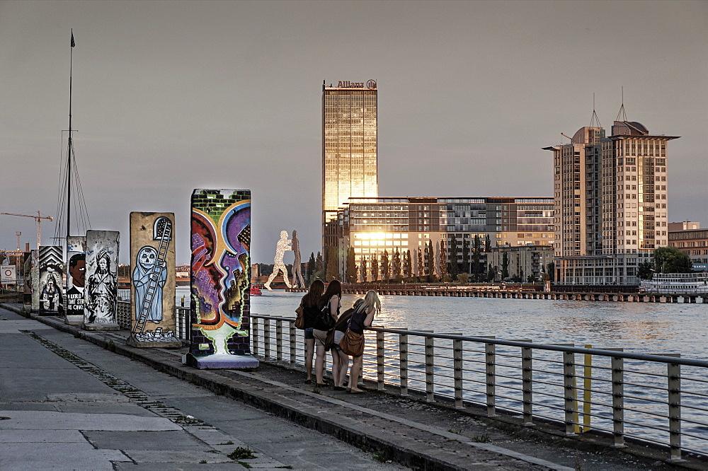 Sections of the Berlin wall in Friedrichshain, river Spree, Treptowers, Allianz building, Molecule man, Friedrichshain, Berlin, Germany