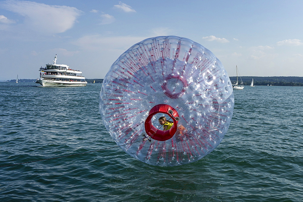 Fun Ball on Lake Constance in Ueberlingen, Ferry in the background, Baden-Wuerttemberg, Germany, Europe