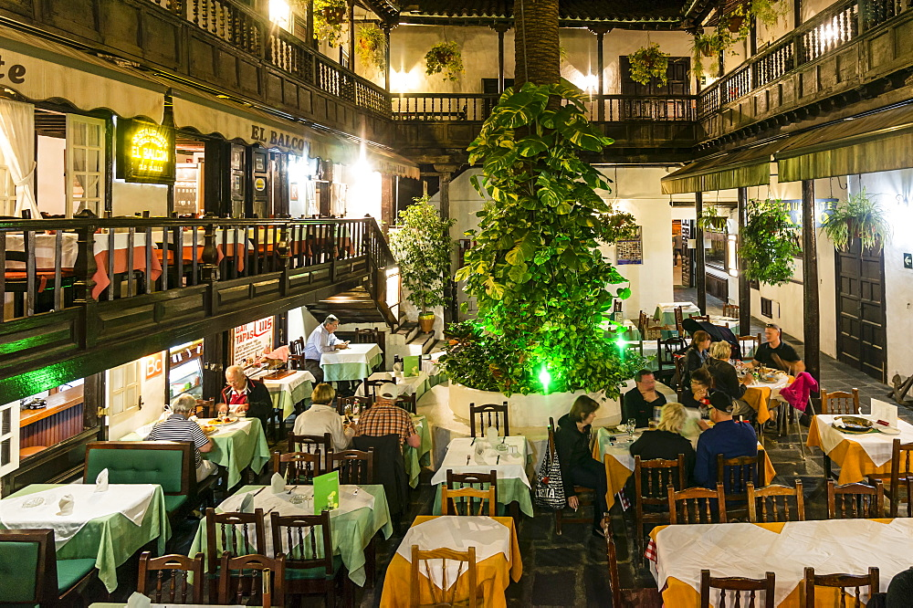 Restaurants in the courtyard, El Rincon at Plaza del Charco, historic building from 17. Century, Puerto de la Cruz, Tenerife, Canary Islands, Spain