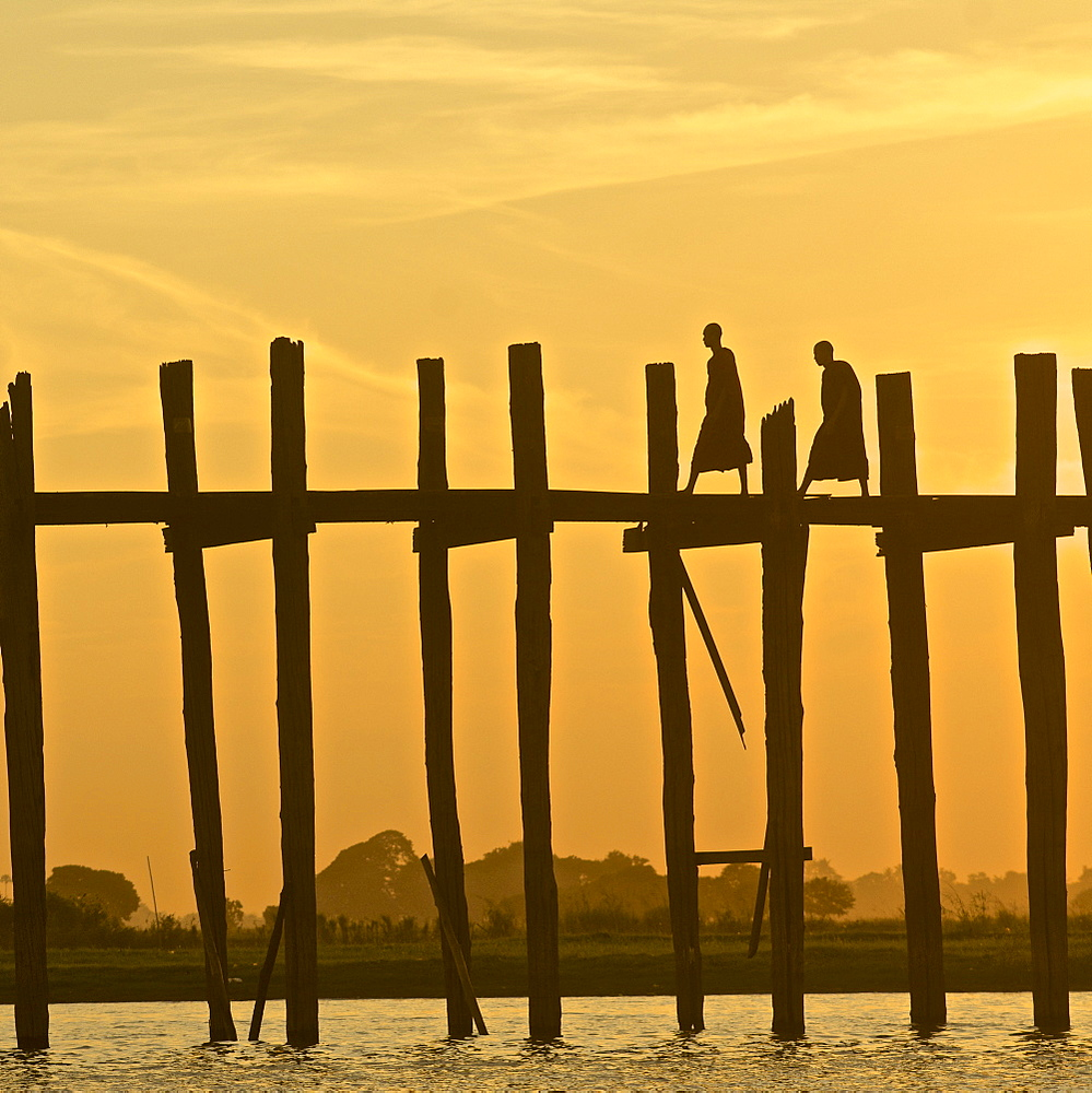 Two monks on the U Bein bridge, 1, 2 km long wooden bridge, Amarapura near Mandalay, Myanmar, Burma