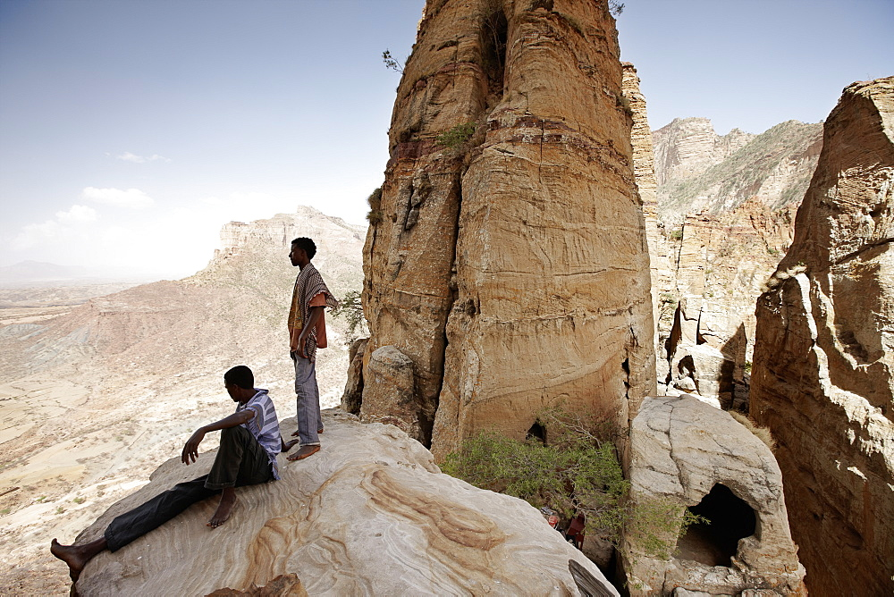 Priest students on a rock, monolithic church Abuna Yemata Guh, Hawzien, Tigray Region, Ethiopia