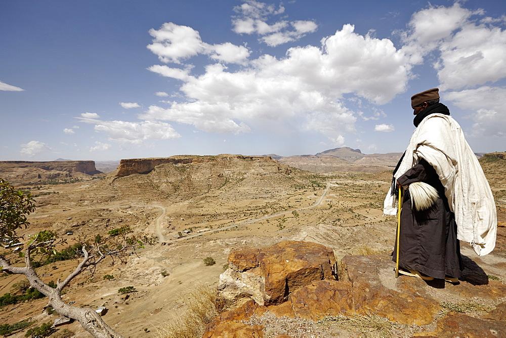 Priest looking over scarp at monastery Debre Damo, near Adigrat, Tigray Region, Ethiopia