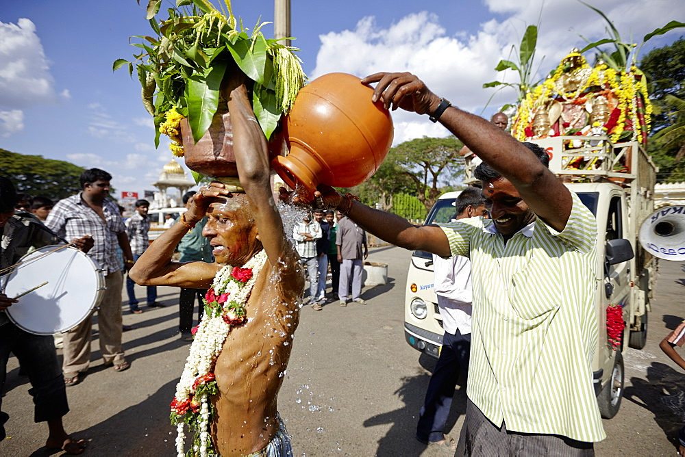 Pilgrim carrying holy water on his head, Mysore, Karnataka, India