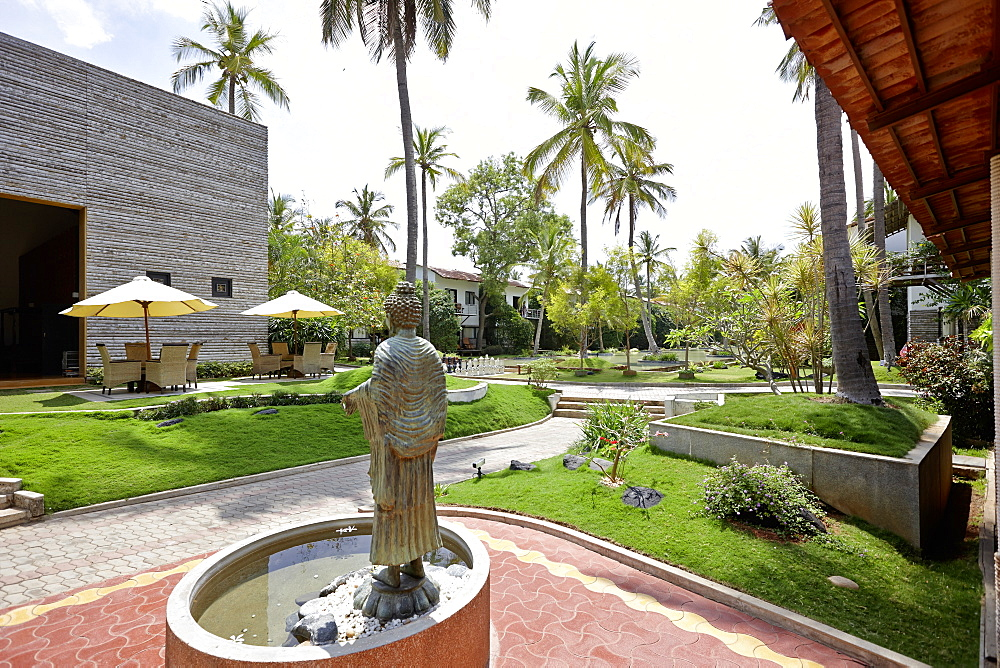 Fountain with Buddha statue in front of a hotel spa, Mysore, Karnataka, India