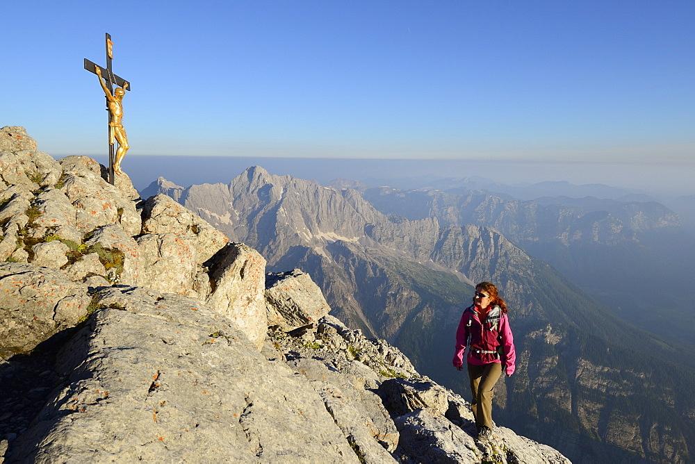 Woman ascending to Hocheck, Hochkalter in background, Watzmann, Berchtesgaden Alps, Berchtesgaden National Park, Berchtesgaden, Upper Bavaria, Bavaria, Germany