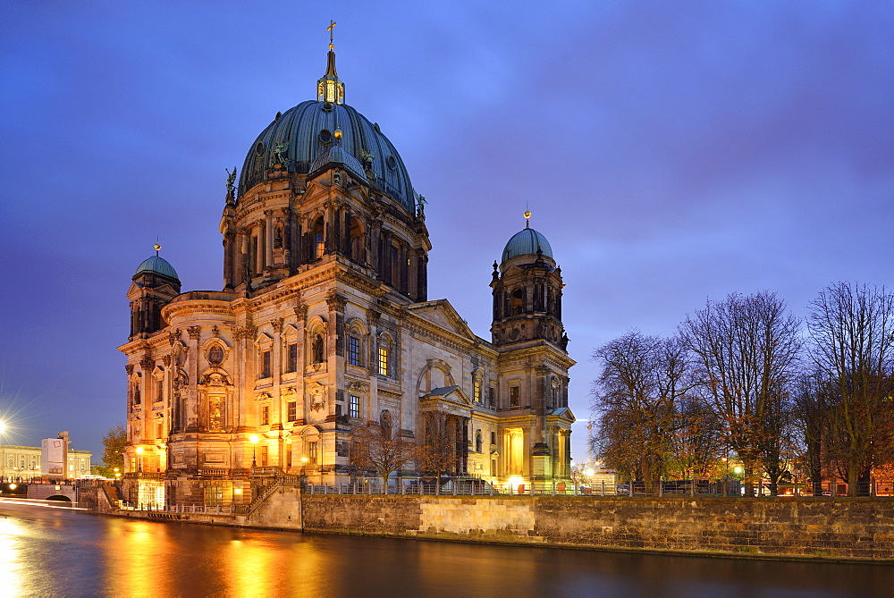 Illuminated Berlin cathedral above the river Spree, Berlin, Germany