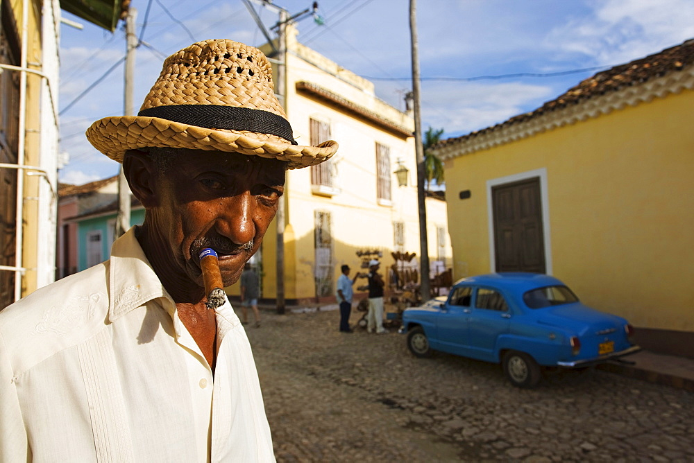 Senior man smoking cigar, Trinidad, Sancti Spiritus, Cuba, West Indies