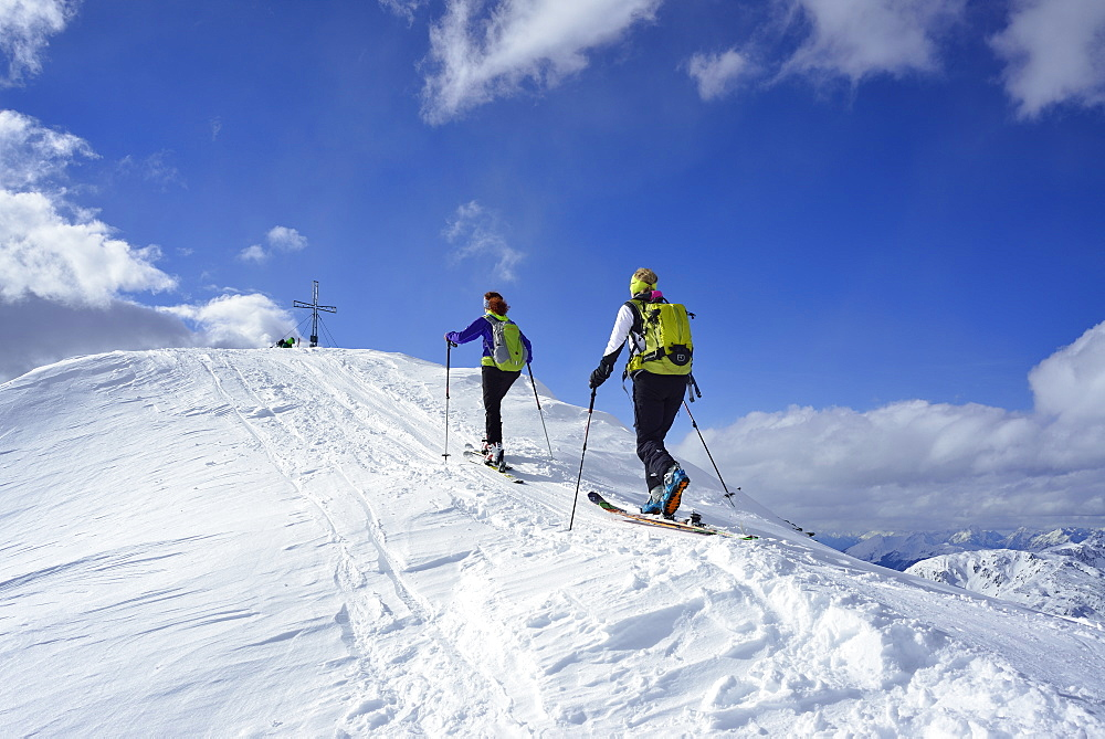 Two female back-country skiers ascending to Schafsiedel, Kitzbuehel Alps, Tyrol, Austria