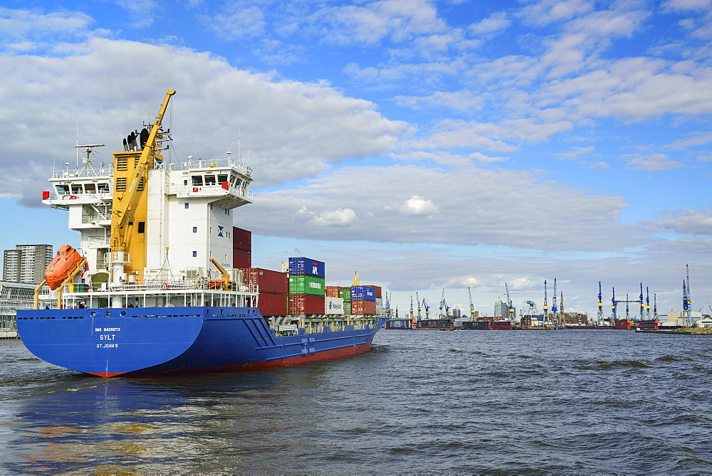 Container ships on the river Elbe towards harbour of Hamburg, river Elbe, Hamburg, Germany