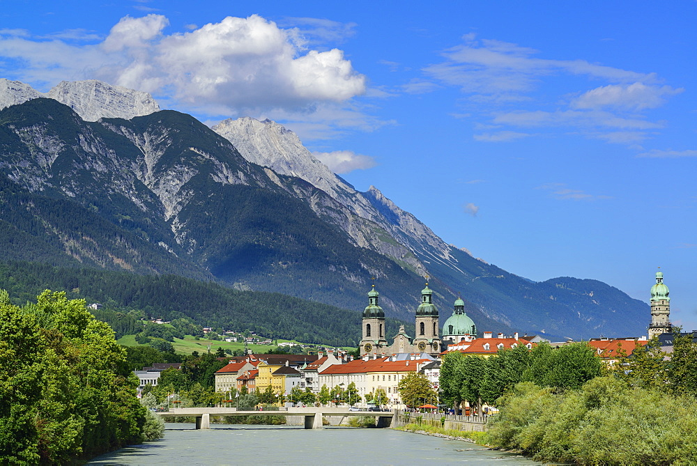 View over Inn river to Cathedral of St. James and City Tower, Karwendel with mount Bettelwurf in background, Innsbruck, Tyrol, A
