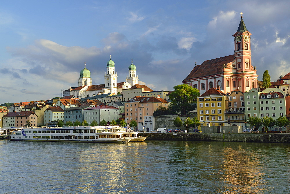 View over Danube river to old town with church of St. Paul and St. Stephans Cathedral, Passau, Lower Bavaria, Germany