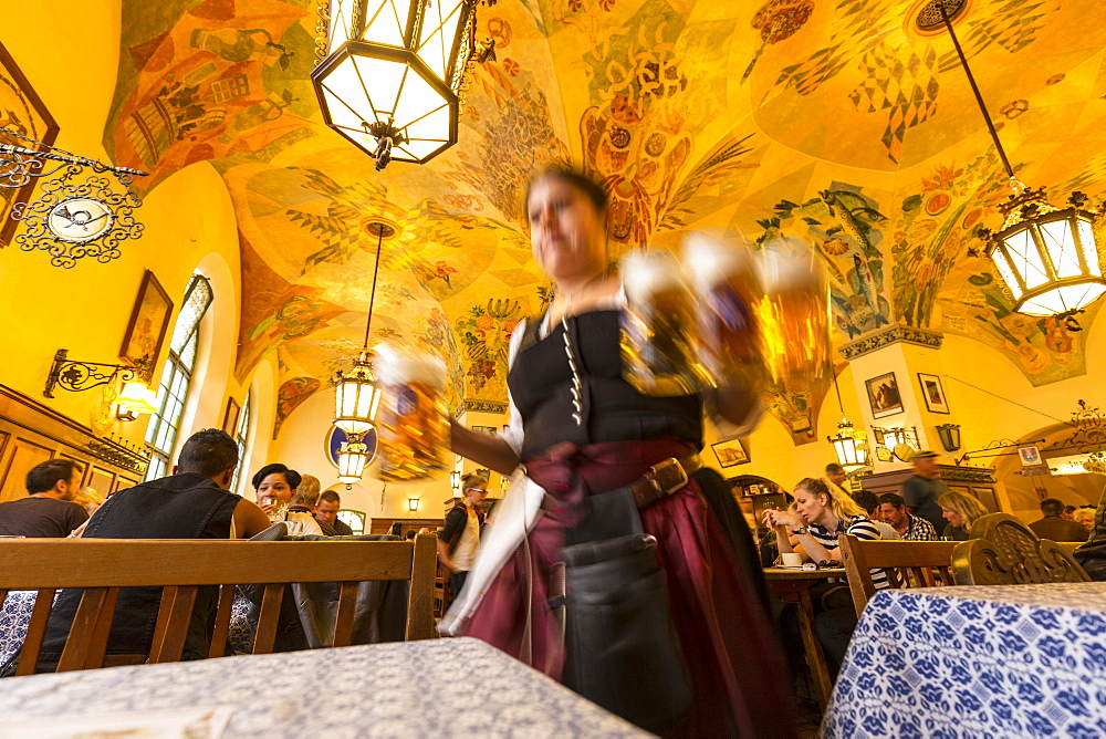 Waitress carrying beer in Hofbraeuhaus, Munich, Upper Bavaria, Bavaria, Germany