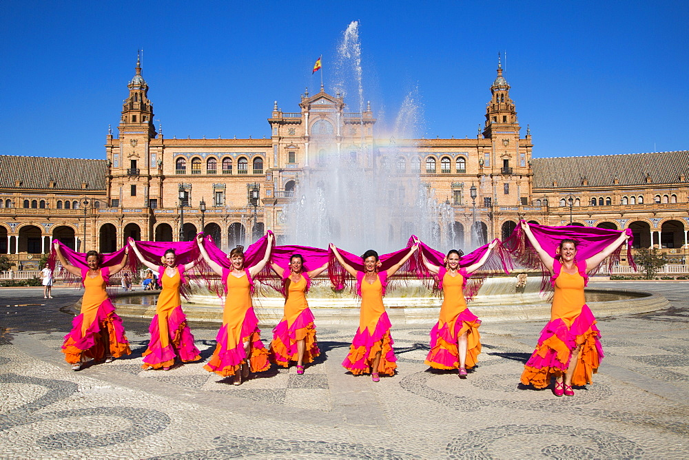 Flamenco Fuego dance group on Plaza de Espana in front of the fountain, Seville, Andalusia, Spain