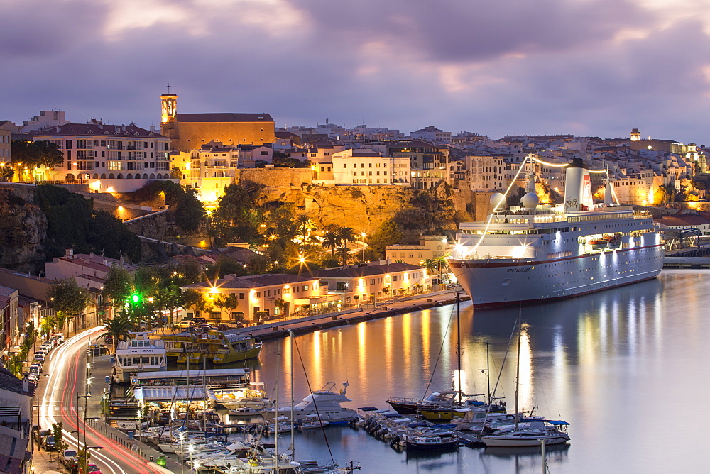 Cruise ship MS Deutschland (Reederei Peter Deilmann) at the pier and old town buildings at dusk, Mahon, Menorca, Balearic Island