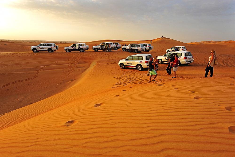 Cross-country vehicles, 4WDs crossing the desert near Dubai, United Arab Emirates