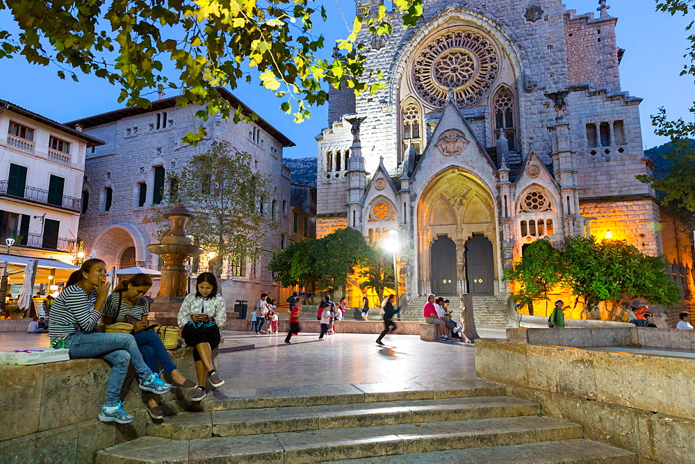 market square with Sant Bartomeu's church in the evening, people chatting, children playing, Soller, Serra de Tramuntana, Majorca, Balearic Islands, Spain, Europe - 1113-102233