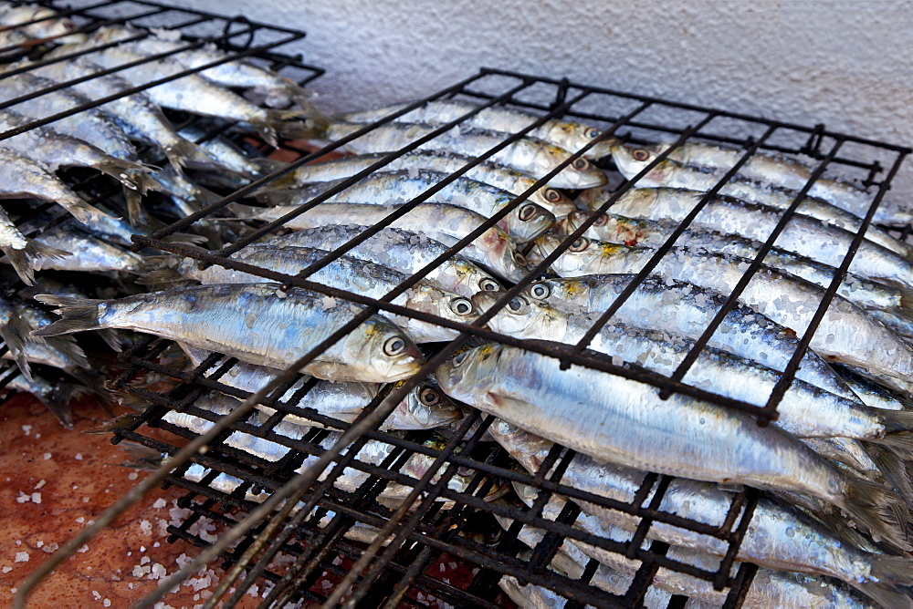 Sardines on a grill rack, Algarve, Portugal