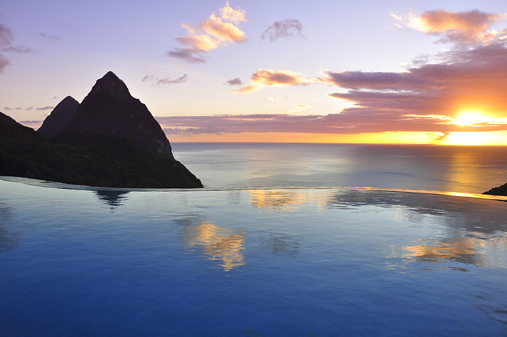 swimming pool of La Haut Plantation hotel at sunset with sea view and volcano mountains The Pitons with Gros and Petit Piton, UNESCO world heritage, Soufriere, St. Lucia, Saint Lucia, Lesser Antilles, West Indies, Windward Islands, Antilles, Caribbean, Central America