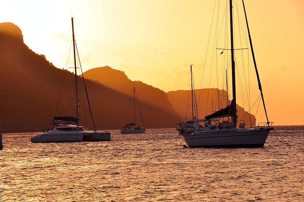 sailing ships at sunset anchoring at Bequia island, sea, St. Vincent, Saint Vincent and the Grenadines, Lesser Antilles, West Indies, Windward Islands, Antilles, Caribbean, Central America