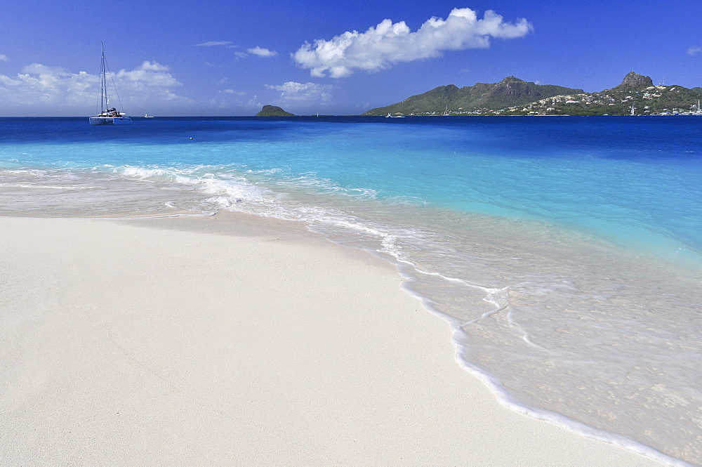 Beach with waves, sailing ship and view to Union Island, sea, Palm Island, St. Vincent, Saint Vincent and the Grenadines, Lesser Antilles, West Indies, Windward Islands, Antilles, Caribbean, Central America