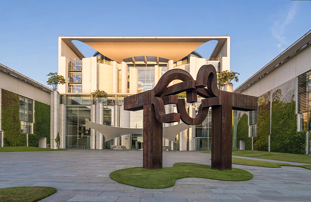 Sunrise at German federal chancellery, Bundeskanzleramt with steel sculpture ''Berlin'' by Basque artist Eduardo Chillida, Berlin, Germany