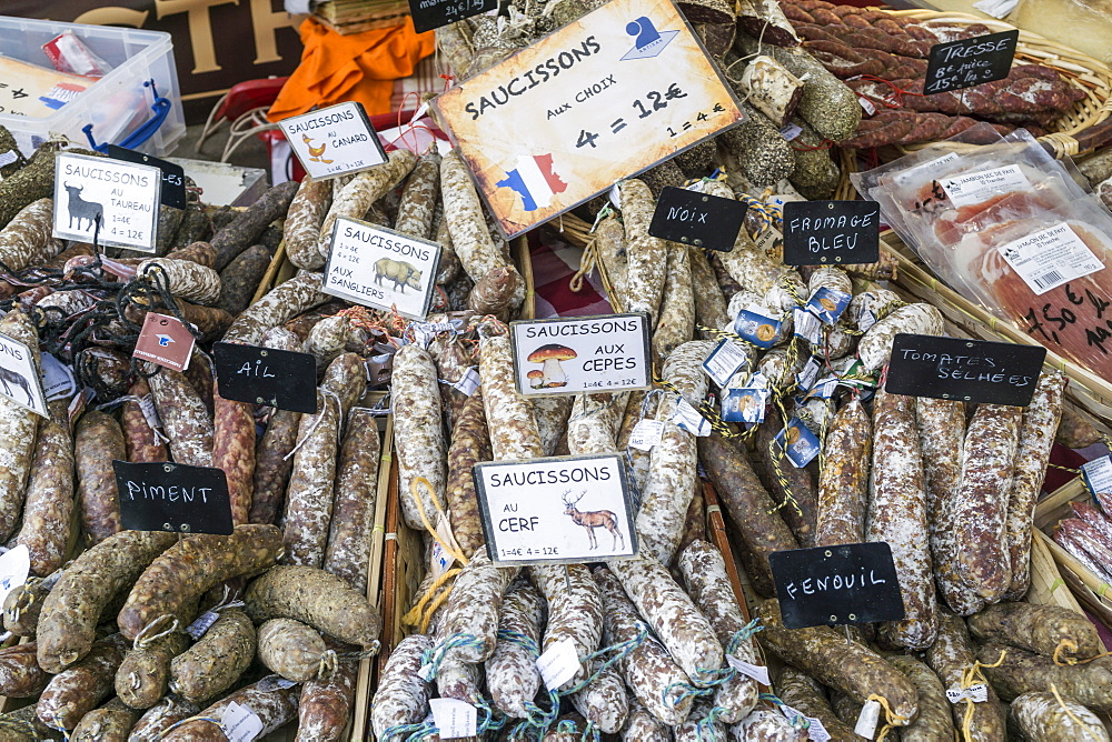 Suassages and salami on the market stall in Lourmarin, Provence-Alpes-Cote d'Azur, France