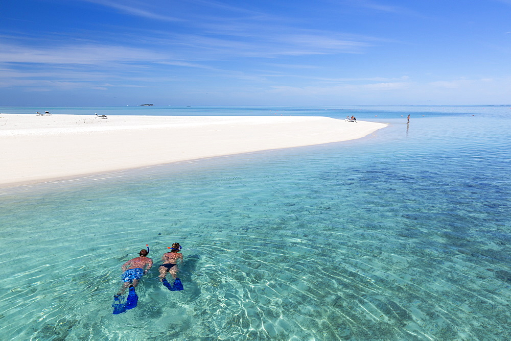 A woman and a man snorkeling along the beach at Meeru Island Resort, Meerufenfushi, North-Male-Atoll, Maldives