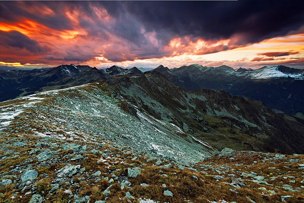 View from Koenigsangerspitze at sunset in the direction of Sarntal valley, South Tyrol, Italy