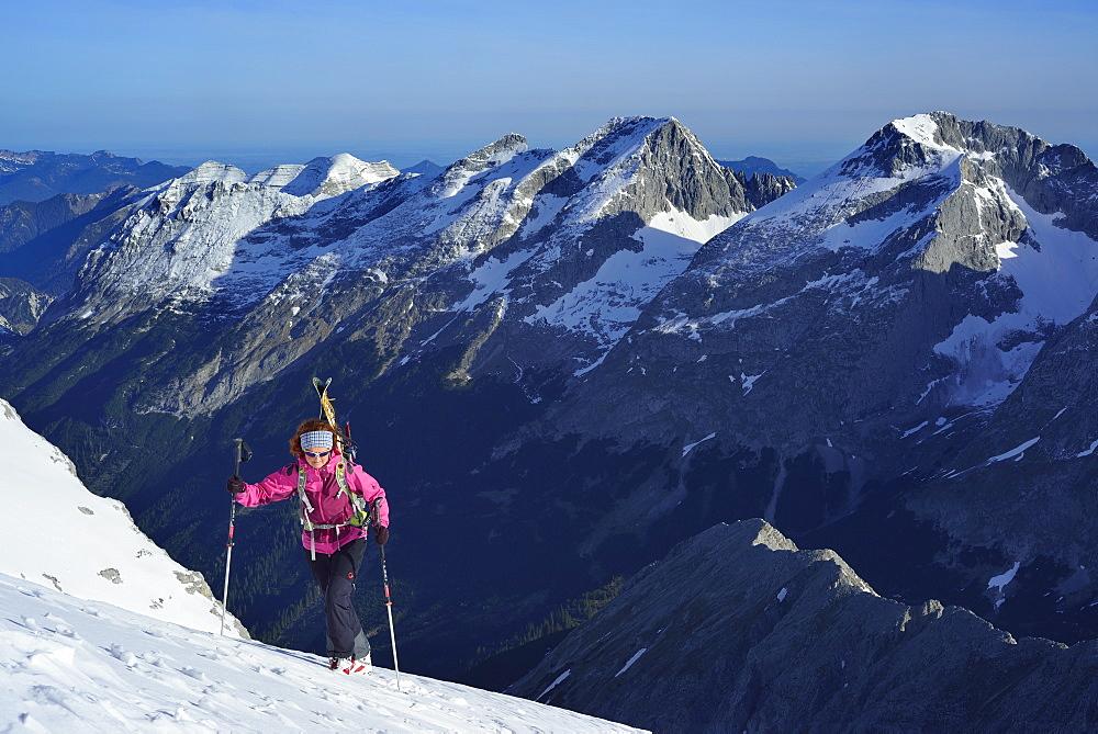 Female back-country skier ascending to Birkkarspitze, Karwendel range, Tyrol, Austria