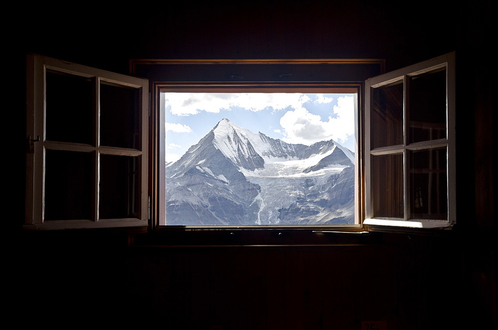 View of the summits of the Weisshorn left and the Bishorn right looking through an open window, Dom Hut, Pennine Alps, canton of Valais, Switzerland
