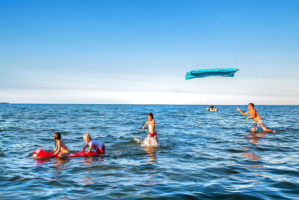 Children playing in the sea, Scharbeutz, Baltic Coast, Schleswig-Holstein, Germany