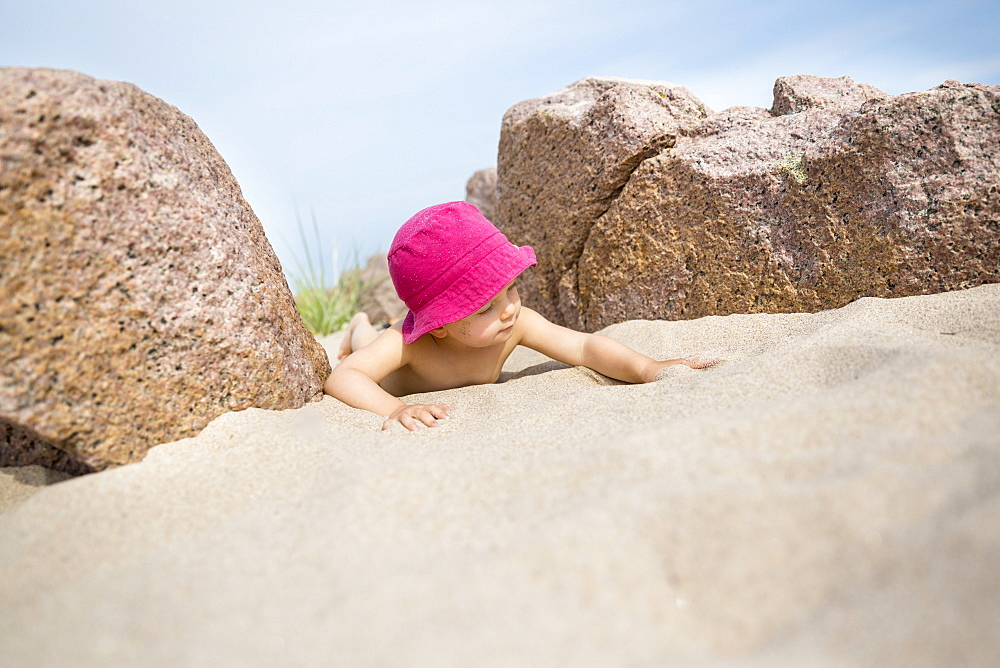 Little girl with sun hat playing on the beach, summer, holiday, family, Baltic sea, MR, Bornholm, Sandvig, Denmark, Europe