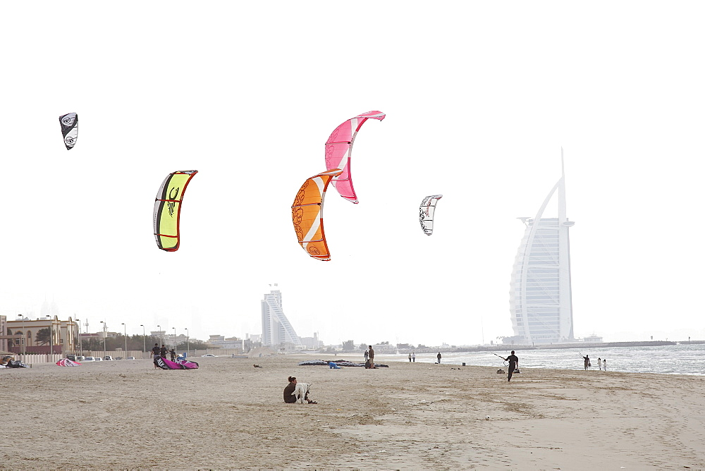 Kite surfers on the beach, Burj Al Arab in the background, Dubai, United Arab Emirates