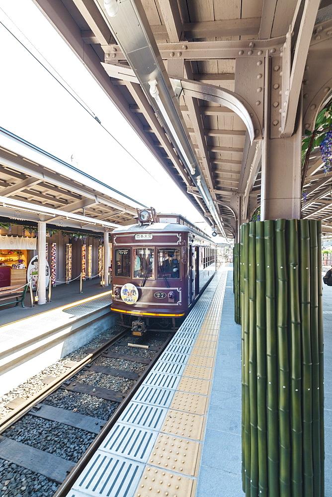 Small train Randen arriving Arashiyama, Kyoto, Japan