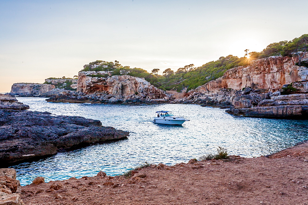 Motorboat next to the Cala s'Almunia beach, Mallorca, Balearic Islands, Spain