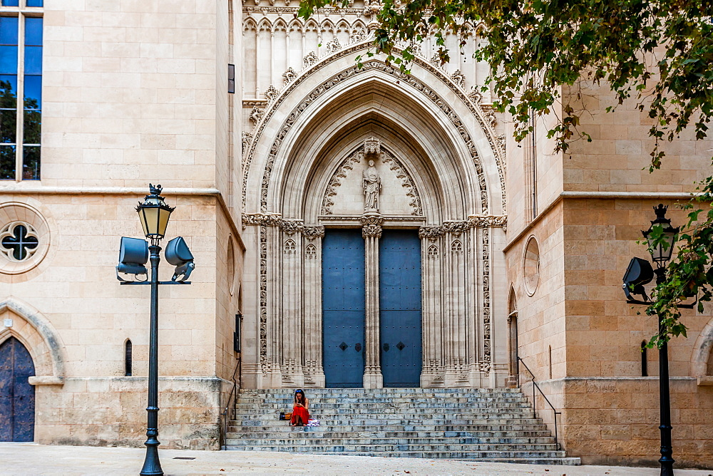 Girl in red skirt, stairs of Iglesia Santa Eulalia, historic city centre, Ciutat Antiga, Palma de Mallorca, Majorca, Balearic Islands, Mediterranean Sea, Spain, Europe