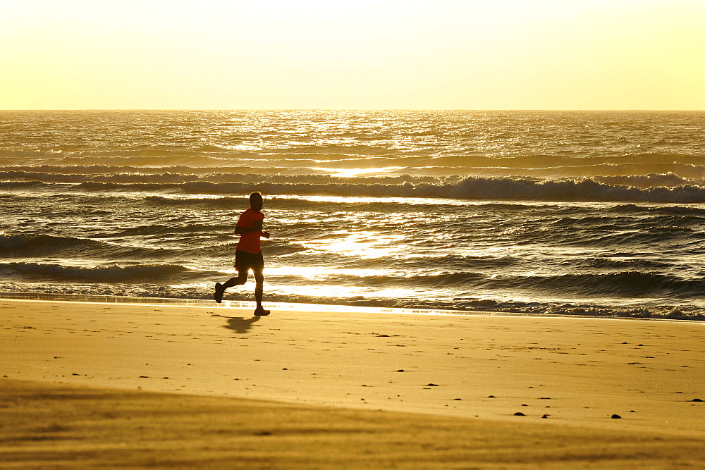 Jogging along the beach at sunrise, Jandia, Playa del Matorral, Jandia Peninsula, Fuerteventura, Canary Islands, Atlantic Ocean, Spain