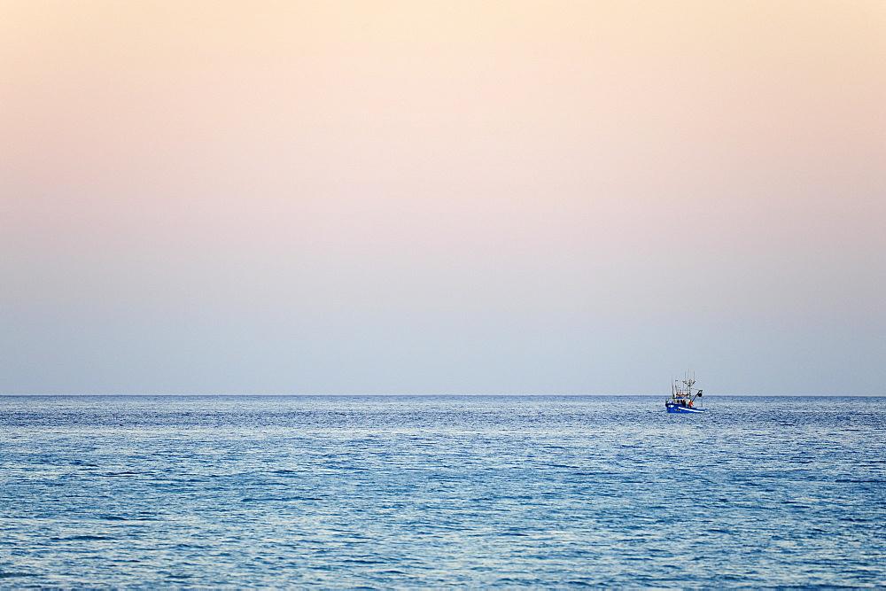 Fishing boat at sunset, Morro Jable, Playa del Matorral, Jandia Peninsula, Fuerteventura, Canary Islands, Atlantic Ocean, Spain