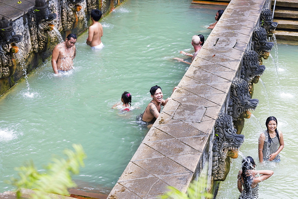 People bathing in hot spring air panas, Banjar Tegeha, Buleleng, Bali, Indonesia