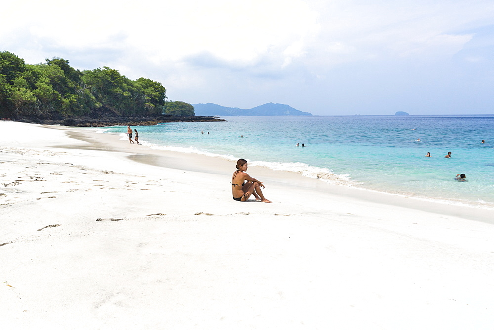 Woman at the white sand beach, Padangbai, Bali, Indonesia