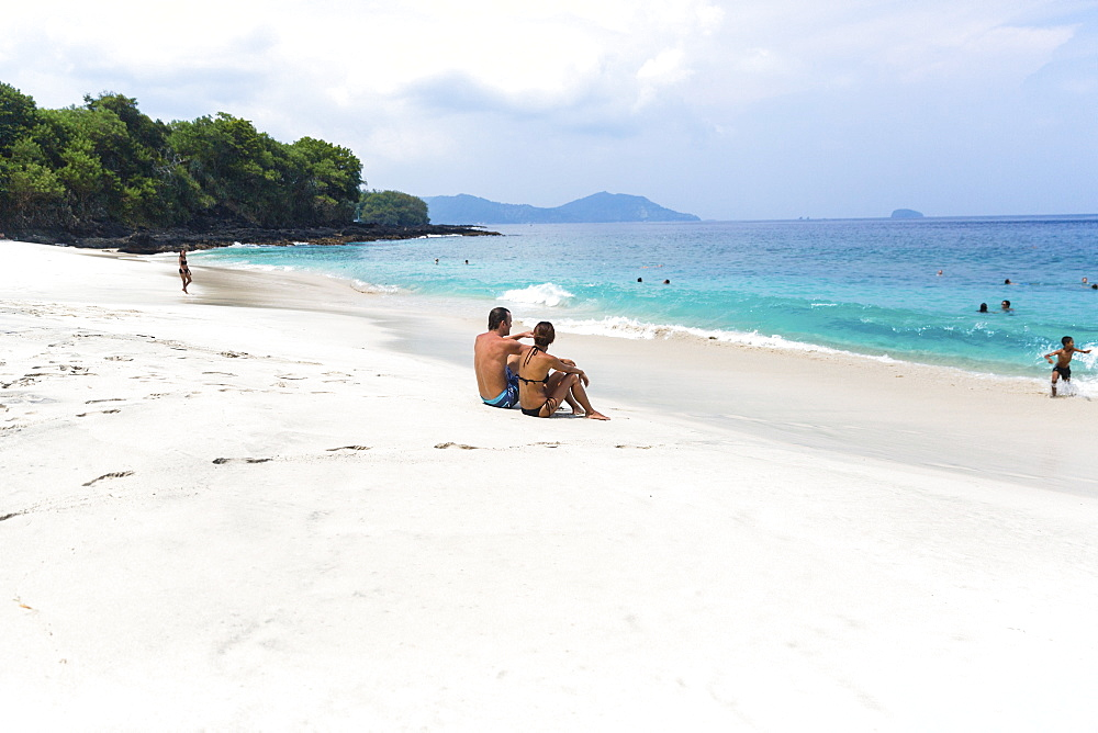 Vacationers at the white sand beach, Padangbai, Bali, Indonesia