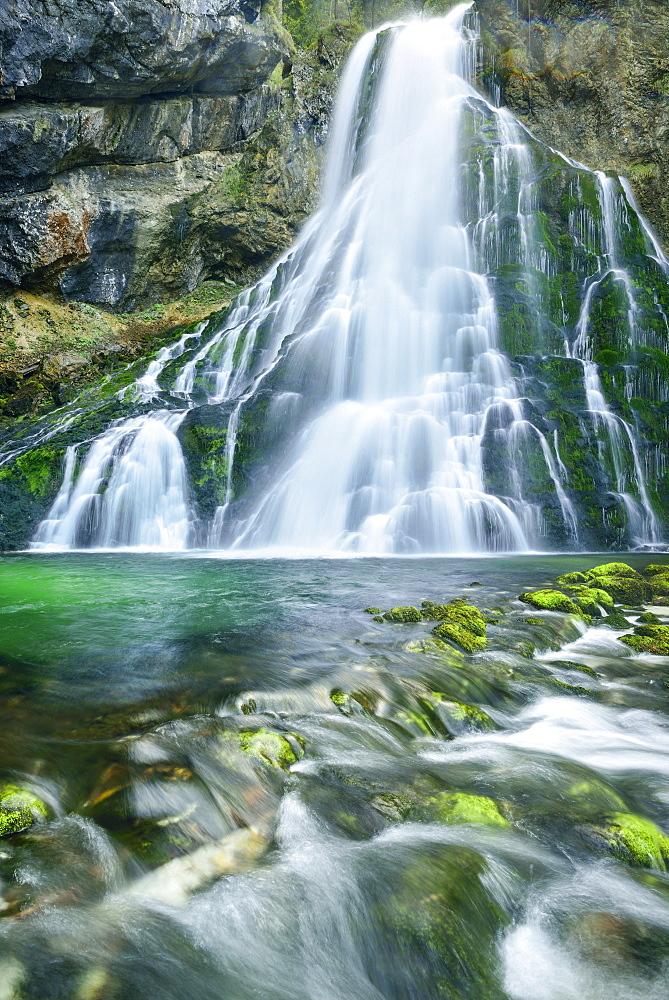 Waterfall cascading in green pond, Gollinger Wasserfall, Golling, Berchtesgaden range, Salzburg, Austria