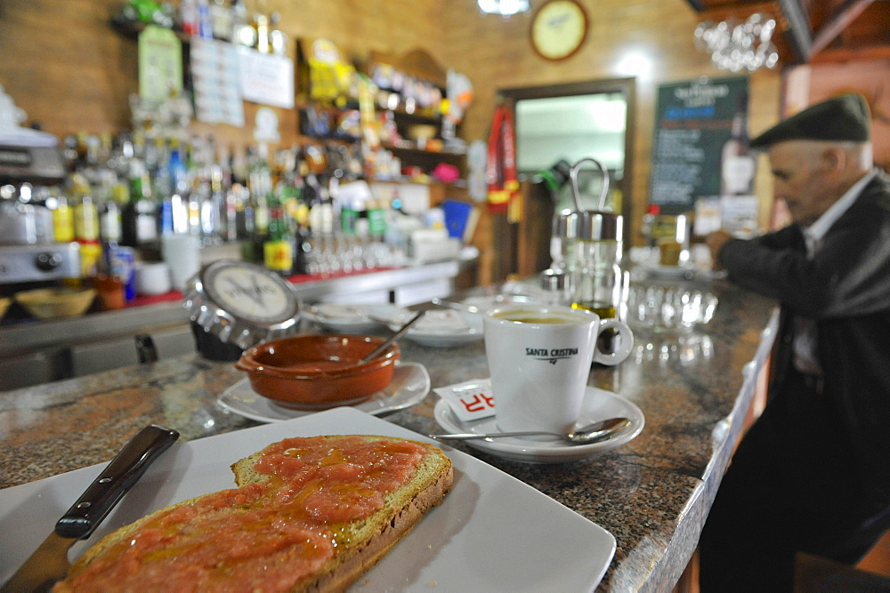 Breakfast with toasted bread and coffee in a bar in Algatocin, Serrania de Ronda, Andalusia, Spain
