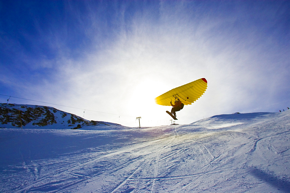 A man with snowboard using a Woopy-Jump, Grimentz, Valais, Switzerland - 1113-103106
