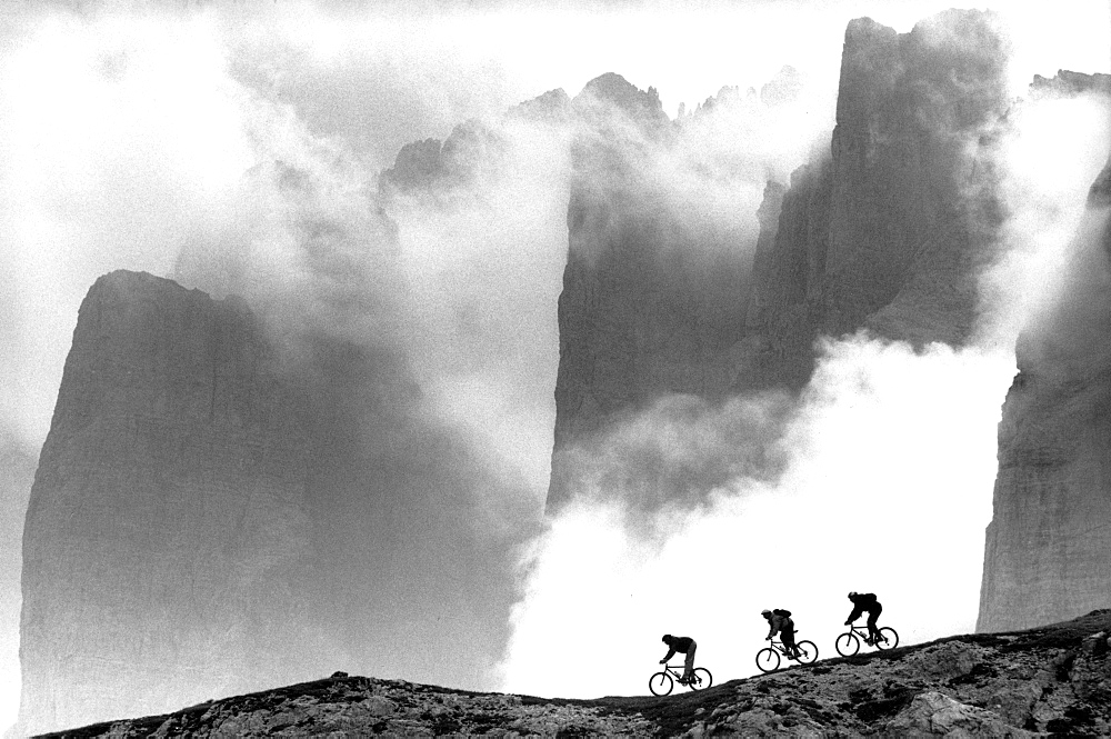 Three male mountain bikers on the way, Dolomites, Italy - 1113-103876