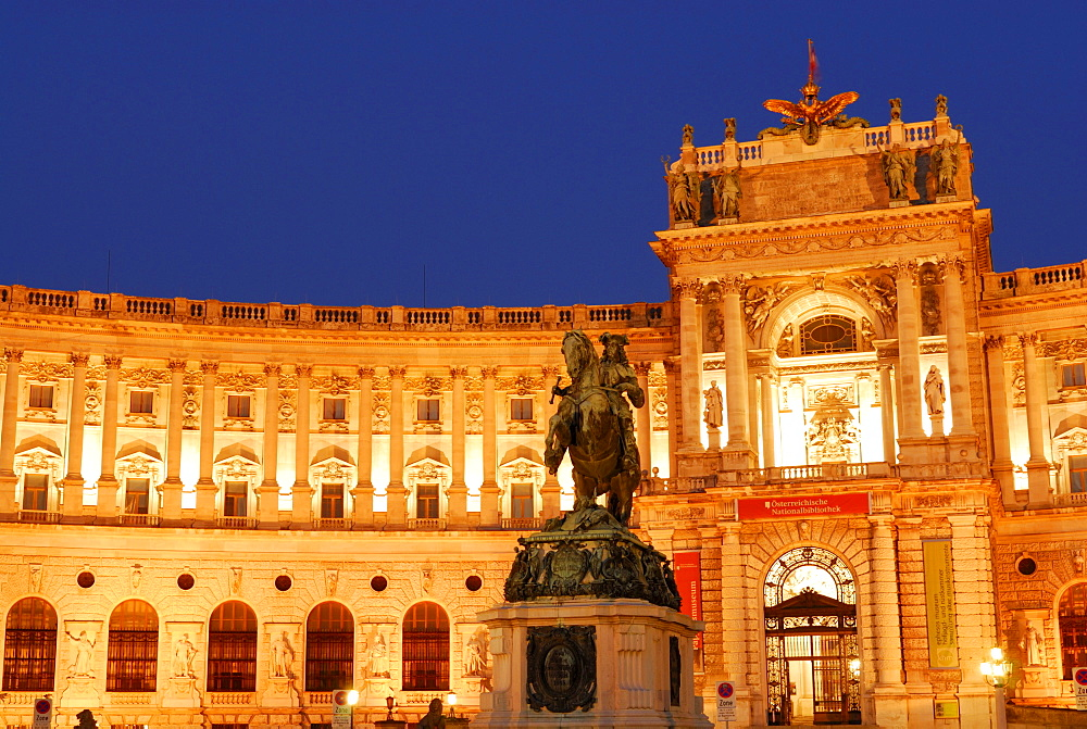 Eugene's monument in front of illuminated Hofburg Imperial Palace, Vienna, Austria