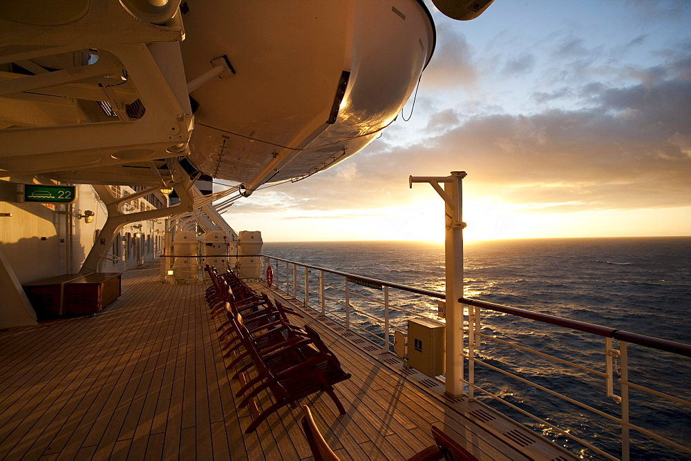 Promenade deck with deck chairs at sunset, Cruise liner Queen Mary 2, Transatlantic, Atlantic ocean