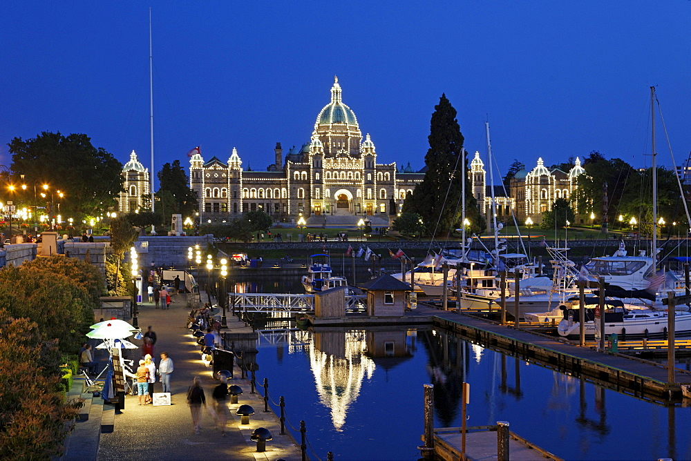 Victoria harbour and illuminated parliament at twilight in Victoria, Vancouver Island, Canada, North America