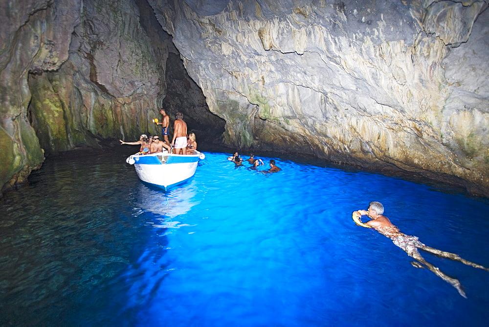 Tourist in the blue grotto, Cape Palinuro, Cilento, Campania, Italy